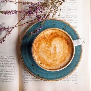 coffee mug on a book