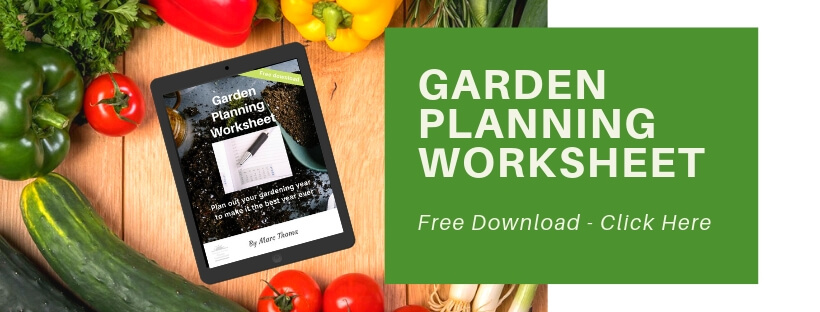cutting board with vegetables and iPad with Garden Planning Worksheet