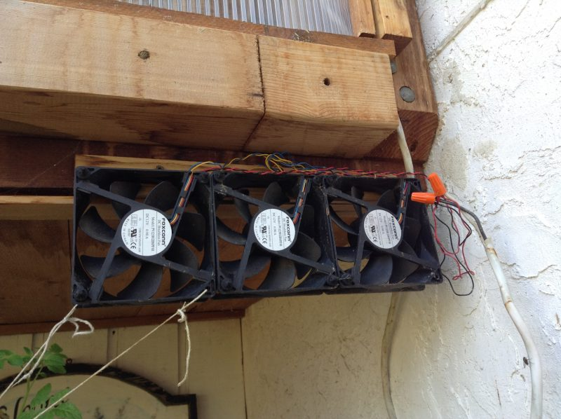 Surplus PC fans in greenhouse connected to solar panel