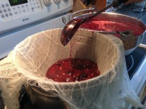 pouring grapes into sieve