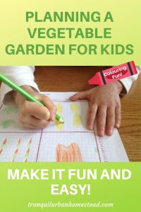 child drawing vegetables on a garden plan