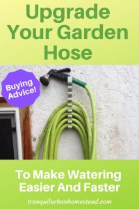 green garden hose on wall