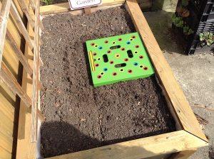 Seeding Square pressed into soil