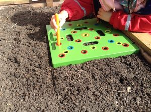 making holes with seeding square wand